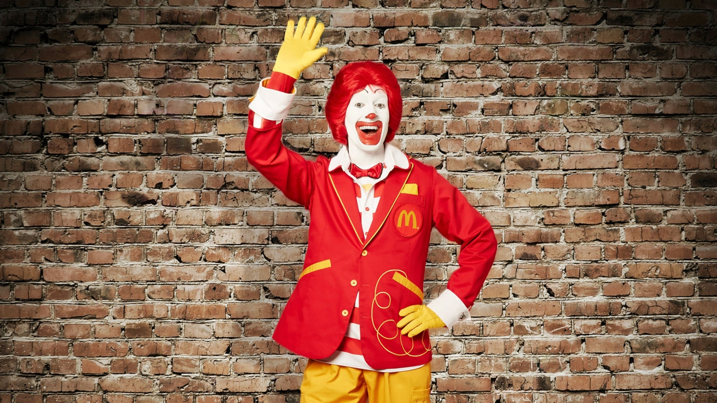 This undated image provided by McDonald's on Wednesday, April 23, 2014 shows the character Ronald McDonald with updated clothing. On Wednesday, the company said the mascot will take an active role on social media for the first time. The move marks a turnaround from recent years, when he faded to the background as McDonald's came under criticism for using him to market to children. But the world's biggest hamburger chain seems ready to give its clown a higher-profile role as it works to boost weak sales. (AP Photo/McDonald's)